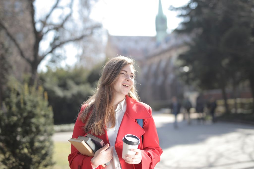 woman in red fall coat